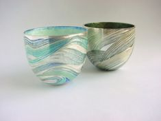 Jane Short - Beakers Material: Standard Silver, Champleve Enamel Size: 5cms high x 6cms diameter Decorative beakers, enamelled outside and inside, with imagery drawn from the natural landscape Contemporary British Silversmiths » Members' Gallery