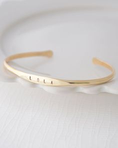 Name Bangle Bracelet - Hand stamped open bangle in copper or brass by Olive Yew. Choose up to 10 characters.