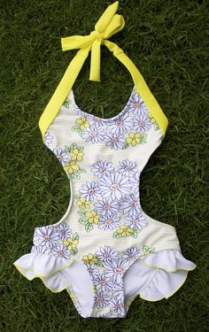 This is one of the most feminine and favorite fits of the one pieces. It features the sweetest bow on the bum and ruffles at the hip. Fuller coverage bottom so fits a swim diaper nicely. Perfect for e