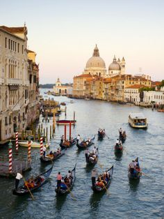Flotilla of Gondolas Heading Toward Chiesa Di Santa Maria Della Salute in early evening.  Venice, Italy