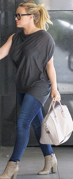 Va va voom! Hilary Duff shows off hourglass figure... while husband Mike pushes…