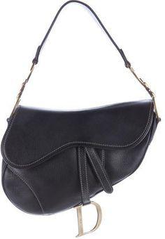 Christian Dior Leather Saddle Bag  https://api.shopstyle.com/action/apiVisitRetailer?id=625099201&pid=uid2500-37484350-28