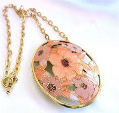 A vintage floral rose pendant