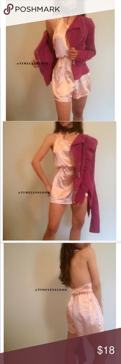 """Light baby pink silky silk halter romper •brand new  •ships tomorrow •brand : TIMELESS look boutique  •no trades  •true to size  •material: 60% poly 40% satin - a+ elastic band stretch- super soft fabric can be worn as a basic piece and accessorize statement pieces and accessories w it - a cool jacket and choker like me or w a jean jacket and cool heels 😍  Model: goguios in insta 📸 (account manager) modeling XS- jacket not included   Please visit """"Closet Rules"""" for more info about us :)…"""