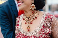 29a Indian reception bridal ruby red jewelry. More here - http://www.indianweddingsite.com/beautiful-illinois-fusion-sikh-wedding-almond-leaf-studios/