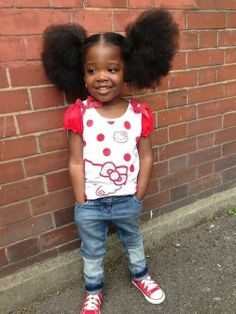 looking adorable with her big afro puffs