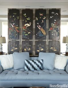 An Asian lacquer screen backs a custom-made sofa upholstered in Quadrille's Colombe.    - HouseBeautiful.com
