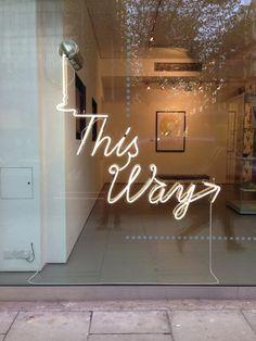 Creative neon typography sign installation @ualartseen head office storefront window