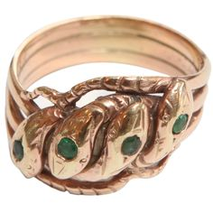 Unusual 14k Four Headed Snake Ring with Emeralds | From a unique collection of antique and modern miscellaneous jewelry at https://www.1stdibs.com/furniture/more-furniture-collectibles/miscellaneous-jewelry/