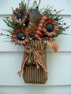 Primitive decor~navy ticking sack~flag~sunflowers~rusty bells~americana in Patriotic Wreath, Patriotic Crafts, July Crafts, Summer Crafts, Holiday Crafts, Fourth Of July Decor, 4th Of July Decorations, July 4th, December