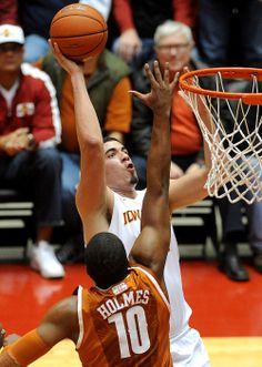 Iowa State's Georges Niang takes a shot over Texas' Jonathan Holmes during the first half Tuesday at Hilton Coliseum. Photo by Nirmalendu Majumdar/Ames Tribune Iowa State Basketball, Iowa State Cyclones, Take A Shot, Tuesday, Texas, Texas Travel
