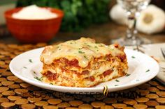 40 Minute Quick and Easy Cheesy Meat Lasagna 1 ½ pounds hot Italian chicken sausage 2 (14.5 ounce) cans Hunt's Fire Roasted Diced Tomatoes with Garlic 1 (8 ounce) can Hunt's Tomato Sauce 2 tablespoons Hunt's Tomato Paste 1 egg 1 (16 ounce) container part skim ricotta cheese ½ teaspoon fresh ground pepper ½ teaspoon kosher salt ¾ cup KRAFT Grated Three Cheese Parmesan Cheese, divided 10 oven ready lasagna noodles 1 ½ (8 ounce) packages KRAFT 5 Cheese Italian Blend Shredded Cheese,