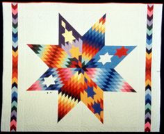 Crazy Star Quilt, 1994-95. Made by Nellie Star Boy Menard (Sioux), Rosebud, South Dakota. 79 x 96 inches.    Collection of Michigan State University Museum. Courtesy of the MSU Museum.