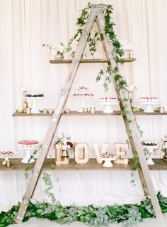 Transform an old ladder into the perfect reception decor! http://www.stylemepretty.com/california-weddings/2016/01/21/an-event-coordinators-dreamy-organic-romantic-backyard-wedding/ | Photography: Daphne Mae - http://www.daphnemaephotography.com/
