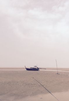 The lonely boat on the beach of Koh Yao Yai