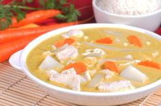 Vegetarian base Yellow Curry. Shown here with Chicken. All curries include rice.