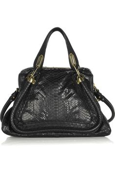 Black leather and python Two top handles, detachable shoulder strap Turn-lock fastenings to expand sides Piped trims, gold hardware Internal zip-fastening pocket, fully lined in black twill Zip fastening along top Python: Vietnam