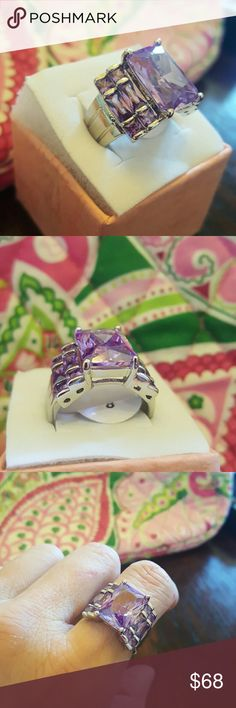SIZE 8 ?SHOW STOPPER? Amethyst loaded ring This ring is by far the most lively of all. I can't say enough about it, yet you can see for yourself, it is a devine ring indeed.  Center stone is 7 tcw.  Baguettes include 4, with 2 on each side to total 1.3/4 tcw Rounds include 8, with 4 on each side to total 1.5 tcw  10 ct ring ...absolutely stunning beyond.   Silver .925  The reflective factor is at its highest, stunning as ever. Purple, bluea, reds, pinks, greens...so many gorgeous colors.. I…