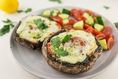 Savory mushroom topped with fresh tomatoes, savory pesto and stringy mozzarella makes a great option for a vegetarian meal.