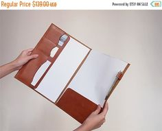 Stitched leather document folder -- 3 compartments for credit and business cards, 2 paper slits and a pen loop with flaps to slide in documents.
