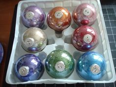 DIY glitter balls from the clear glass ball ornaments at craft stores.  How easy! by syzygy