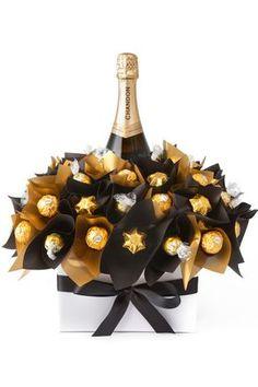 Diy wine n chocolate bouquet Chocolates Ferrero Rocher, Ferrero Rocher Bouquet, Sweet Trees, Wine Gift Baskets, Basket Gift, Champagne Gift Baskets, Navidad Diy, Ideas Navidad, Candy Bouquet