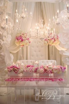 We are in love with this decor for a head table, chandeliers, lucite and pink! Designed by Rachel Clingen Toronto