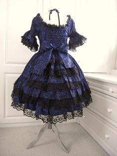 Classic or Gothic Lolita Bustle Dress by Femme Jolie . Boutique Could also work for Steampunk styles.  Heavily tiered and ruffled view of the bustle shirt of this gorgeous purple and black lace dress.