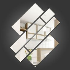 Espelhos decorativos em formato retangular e posicionando em diagonal