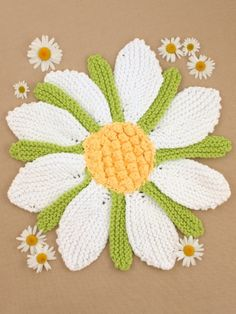 Watch as your kitchen blooms with the Darling Daisy Dishcloth. This fabulously floral knit dishcloth pattern is a fun way to get rid of a few different colors of yarn while whipping up a fun and functional accessory. Dishcloth Knitting Patterns, Crochet Dishcloths, Free Knitting, Crochet Patterns, Crochet Afghans, Crochet Blankets, Knitting Needles, Crochet Stitches, Knitting Supplies