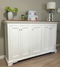 I built this pretty cabinet out of %100 reclaimed fir years ago. My friend painted it. AHHH UGH!!