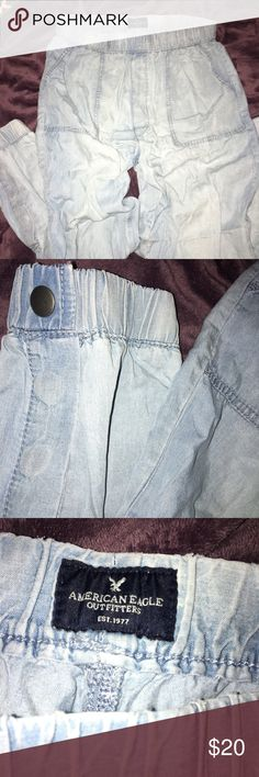 American Eagle Light Wash Jean Jogger Pant- Medium These are light wash denim style jogger pants from American Eagle. They're cinched in at the bottom with a button. I've never work these bc they've always been too big but like most of the things I post I took the tags off before trying it (I gotta stop doing that lol). Really cute and comfortable pants though! Feel free to send offers! American Eagle Outfitters Pants Track Pants & Joggers