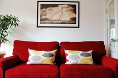 red sofa with grey and yellow cushion