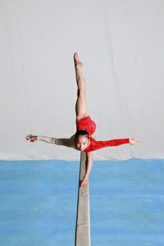 Young gymnast in scale. Pretty ScaleYoung GymnastAction PosesGymnastics FitnessCalisthenics d4bd3f8293bac