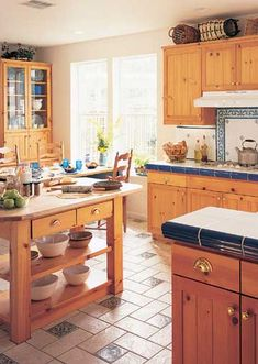 Knotty Pine Kitchen Cabinets- budget friendly and classic. Looks great with blue and white tile. Knotty Pine Cabinets, Knotty Pine Kitchen, Pine Kitchen Cabinets, Kitchen Cabinet Design, Home Decor Kitchen, Rustic Kitchen, Country Kitchen, Home Kitchens, Kitchen Dining