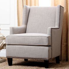 With a stylish nailhead trim, this gorgeous chair is a comfortable and trendy addition to your home. Enjoy this classic, luxurious linen chair from Abbyson Living for years to come.