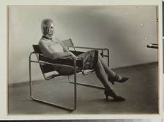 Erich Consemüller, Lis Beyer or Ise Gropius sitting on the B3 club chair by Marcel Breuer and wearing a mask by Oskar Schlemmer and dress fabric by Lis Beyer, c.1927