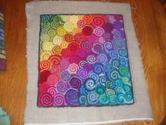 Geometric Pillow #2, Designed and hooked by Leslie Annen. This is beautiful.  I love the color and swirl pattern.