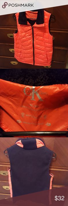 Calvin Klein coral puffer vest Good, used condition. Sweater material in back. Mp3 player pocket. Wind resistant. Calvin Klein Jackets & Coats Vests