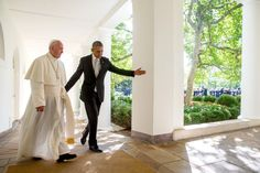 President Barack Obama and Pope Francis walk down the Colonnade before meeting in the Oval Office of the White House.