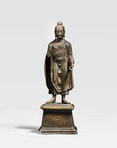 Bonhams Fine Art Auctioneers & Valuers: auctioneers of art, pictures, collectables and motor cars Standing Buddha, Asian Sculptures, Southeast Asian Arts, 17th Century Art, Old Cemeteries, Angel Statues, Buddhist Art, Luxor Egypt, National Museum
