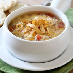 Slow Cooker Chicken Tortilla Soup Recipe Soups with chicken breasts, corn kernels, diced tomatoes, chicken stock, onion, green pepper, serrano peppers, garlic, chili powder, salt, ground pepper, monterey jack, tortillas