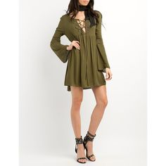 Charlotte Russe Lace-Up Babydoll Dress ($35) ❤ liked on Polyvore featuring dresses, olive, bell sleeve dress, olive green dress, white mini dress, white empire waist dress and short white dresses