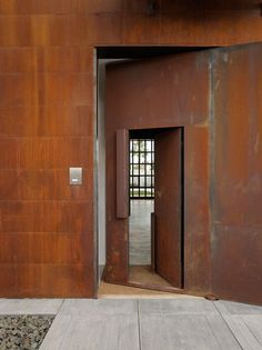 Seattle-based Olson Kundig Architects has designed the live-work home of a photographer and his family in the Spanish coastal town of Sitges. In Studio Sitges, Tom Kundig pursues his macho signature; large scale, raw concrete and rusty Corten steel. Sitges, Pivot Doors, Steel Doors, Entrance Doors, Entrance Ideas, Minimalist Living, Door Design, Windows And Doors, Interior Architecture
