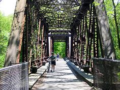 Wallkill Valley Rail Trail. Cycle through an orchard, rail bridge and right into New Paltz. Such a treat!