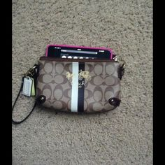 Authentic Coach wristlet ✈️ Shipping The outside is in good condition but the inside has makeup stains/dirt from having it a long time and the strap has some threading that can be cut. I can fit my iPhone 6 Plus in here along with other small items. Can be worn two different ways as shown in second and fourth picture. Coach Bags Clutches & Wristlets