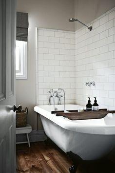 Subway tile behind clawfoot tub
