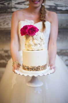 gold sparkle lined round wedding cake with top rosette tier   www.barefootbridal.com