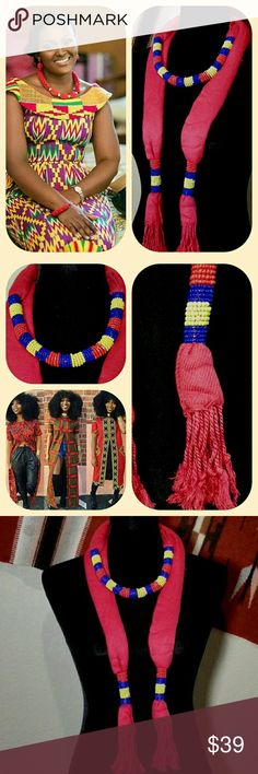 """African Ghanaian/Kenyan Hand Beaded Necklace Scarf African Ghanaian / Kenyan Hand Beaded Wrap Necklace Scarf.  Red fringed cotton scarf wrapped with blue and yellow beads.  African Kente style colors.  Purchased from Ghanaian woman at my local flea market for myself, but never have worn it.  It belongs on a much younger Western Boho African Gypsy Beauty. 64"""" in length plus fringe. Accessories Scarves & Wraps"""