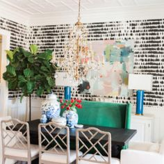 Stunning dining room of lifestyle blogger Nashvilletash. Designer Kendall Simmons used a timeless piece by Erin McIntosh